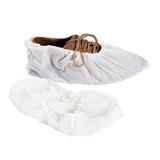 "CROSS LINKED POLYETHYLENE SHOE COVER 18.5"" EXTRA LARGE WHITE, On Shoe Side View And One Loose Shoe Cover"