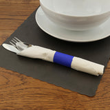 "BLACK PLACEMAT 13.5"" X 9.5"" SCALLOPED, Placemat With Dinnerware and Utensils On Top"