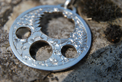 Silver handgraved and perforated pendant