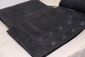 Land Rover Defender Td5 OEM Rubber Front Mats and Transmission Tunnel Trim [Used]