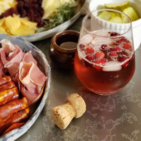 Navona Handmade Negroni Sbagliato with a cheese plate spread