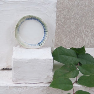 white green and blue jewelry dish