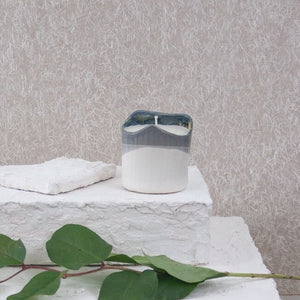 grey and white ceramic candle