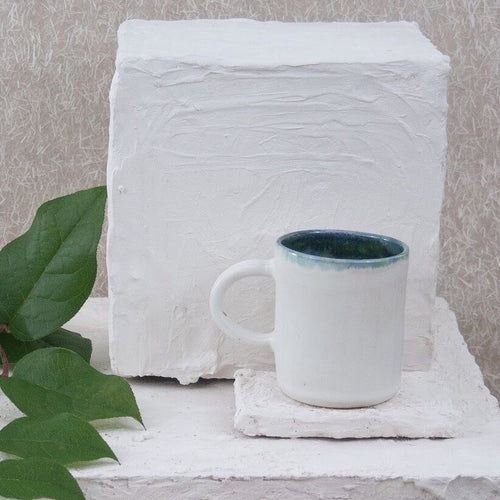 handmade pottery mug in white