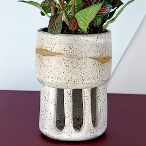 white speckled indoor flower pot