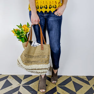 Handcrafted latch hooked alpaca and crocheted jute market bag with reclaimed leather straps