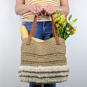 hand crocheted jute tote with alpaca latch hook accent and reclaimed leather double loop handles