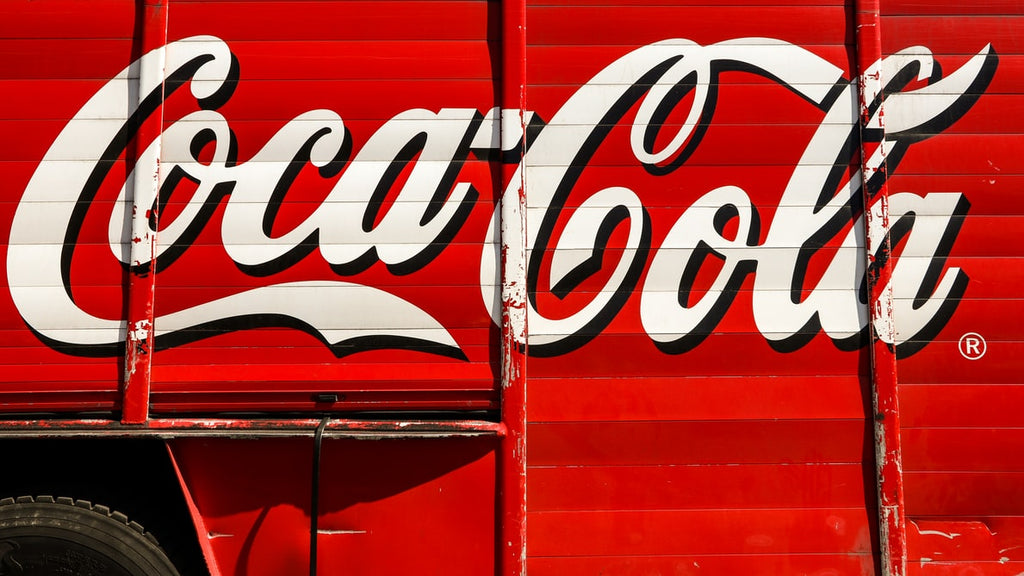 Coca Cola logo on a delivery truck
