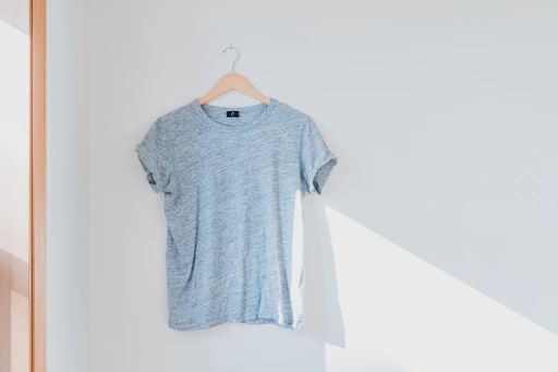 woman's shirt hanging on a clothes hanger
