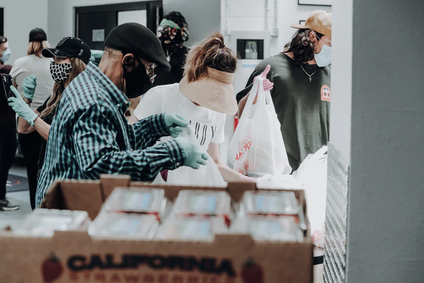 a group of people donating clothing