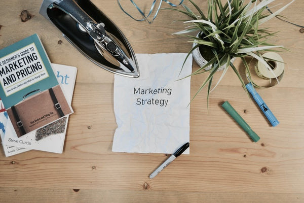 marketing materials scattered on a desk