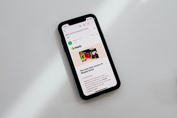 Shopify app open on a black Iphone