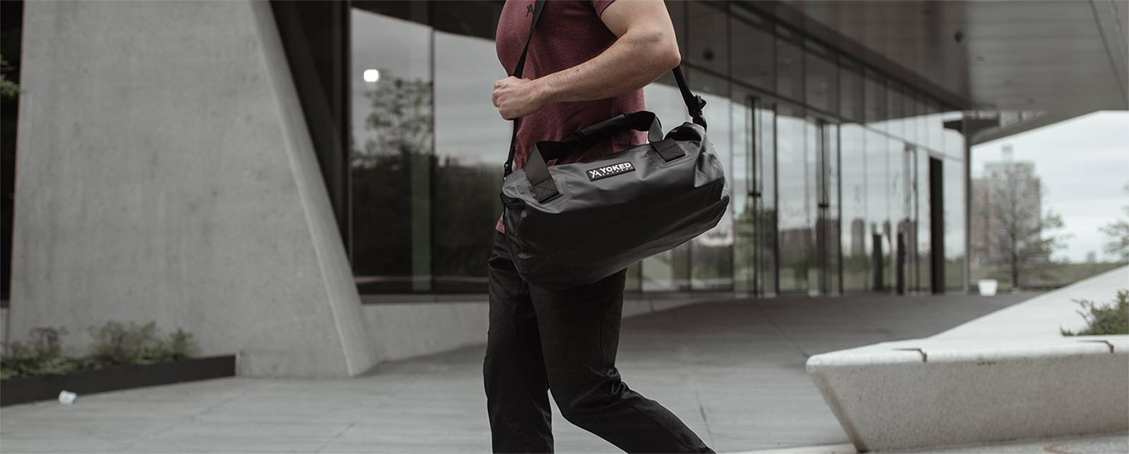 Burgundy muscle fit t-shirt with black tarp waterproof duffel bag YA Yoked Apparel