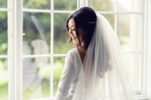 Bride wearing a veil with a Gemma Sutton hair vine