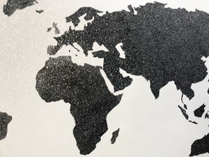 Close Up Shot of a Black and White Painting of the World Map created with Diamond Dust