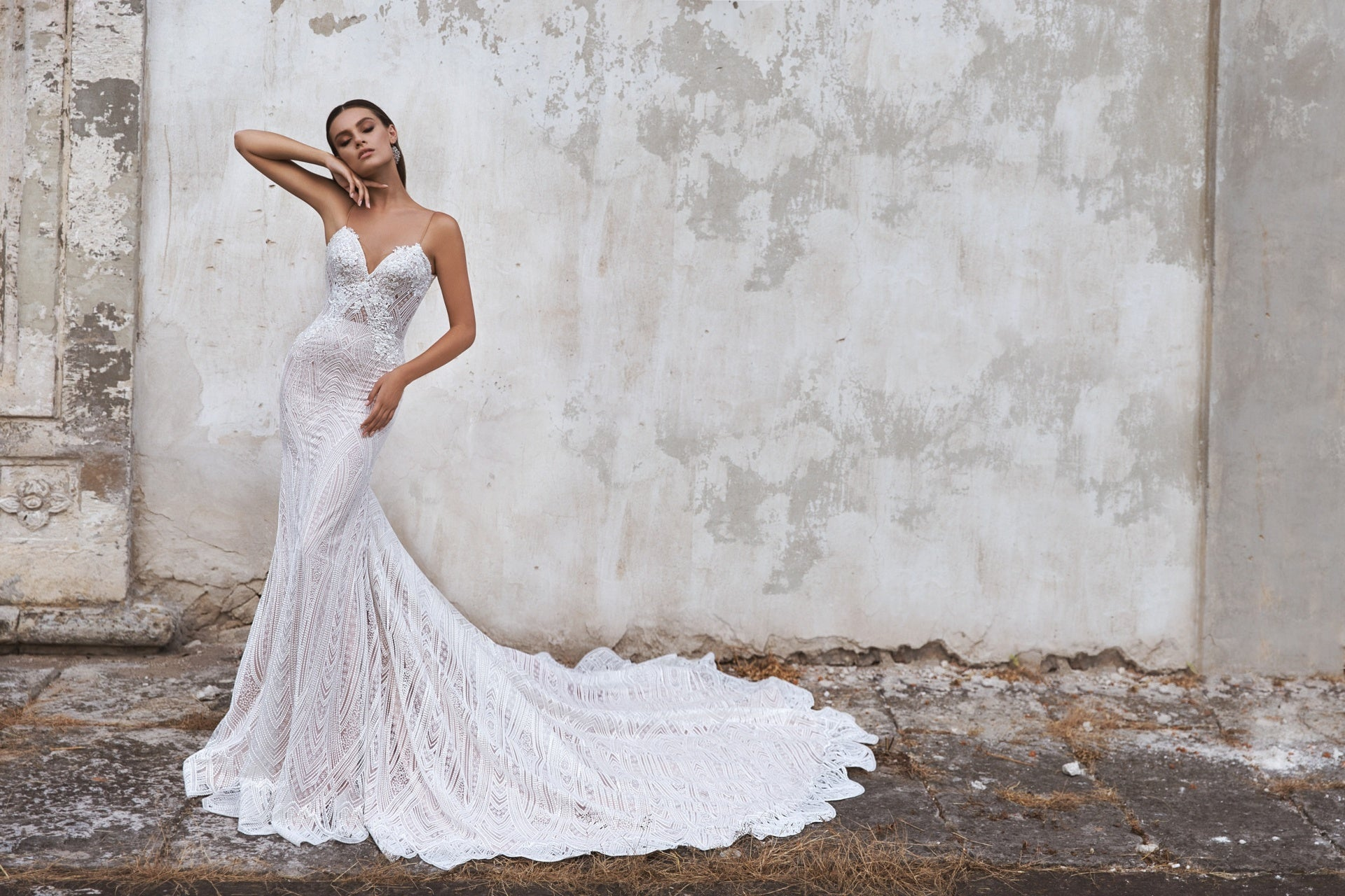 This collection offers a unique approach to garment construction, offering a wide variety of unconventional silhouettes, necklines, and colors, including icy blues and multi-tone ivories.