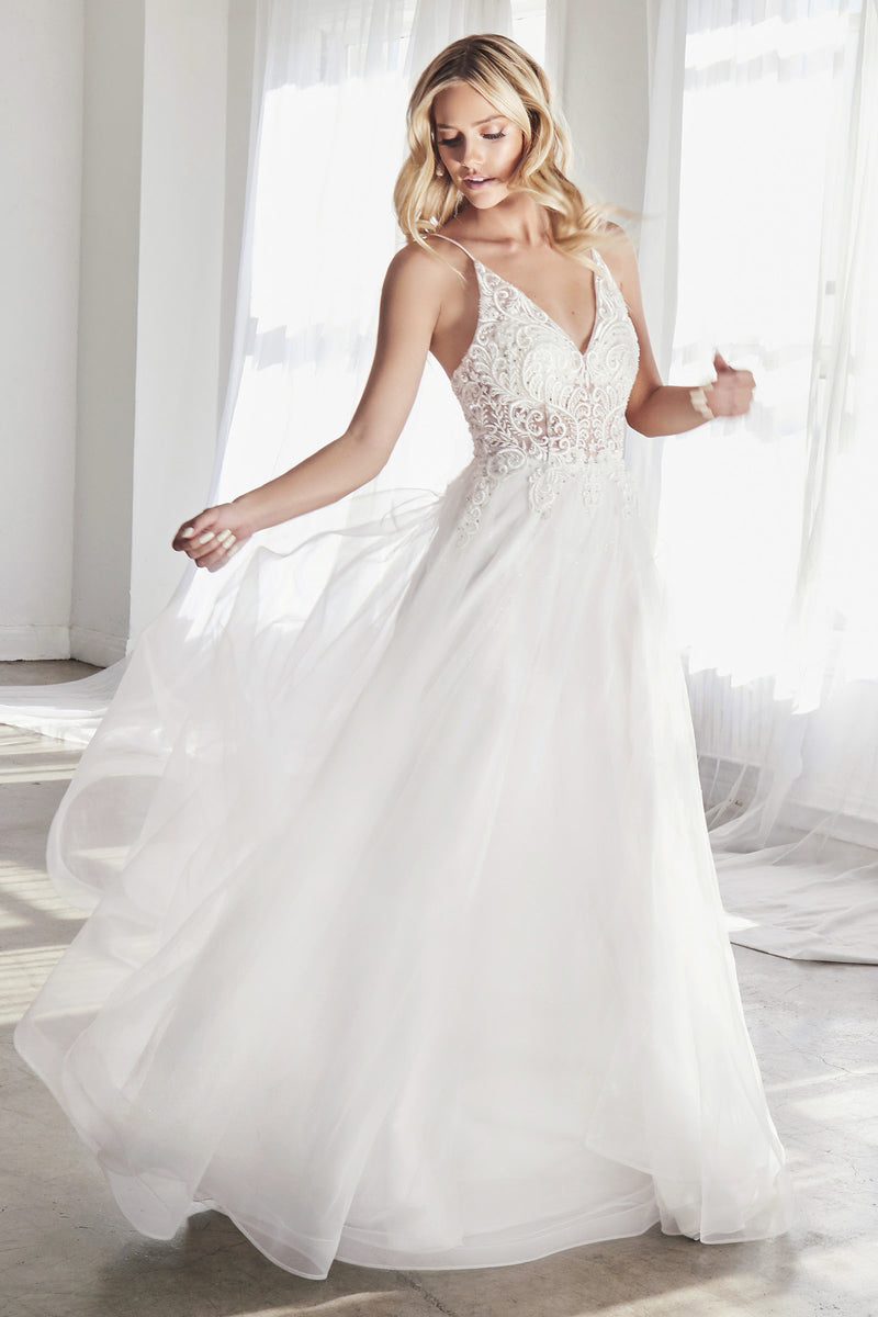 Priced perfectly for an intimate microwedding, this gown has couture beaded embellishment at bodice & multilayer tulle skirt. This photogenic gown with soft volume is a great choice for a backyard wedding.