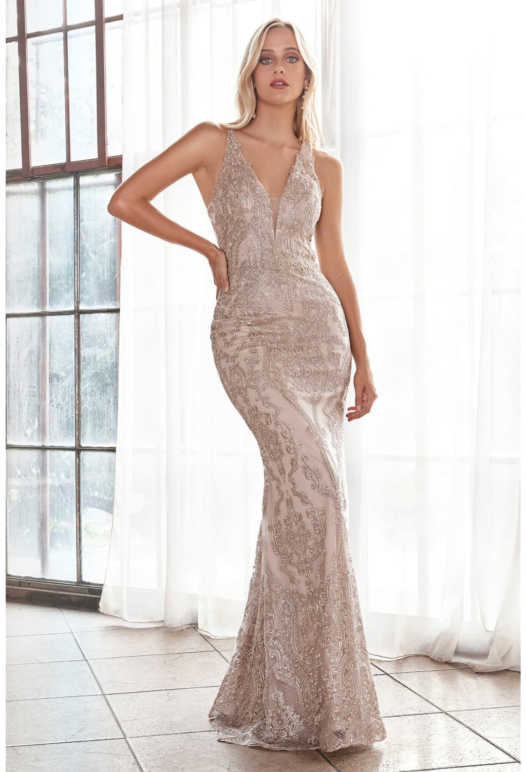 Slim fit lace gown with deep v-neckline and covered lace back