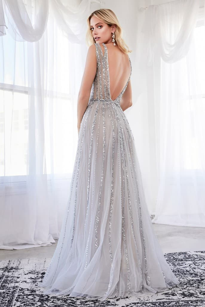 A-line fully beaded gown with v-neckline and semi sheer tulle skirt