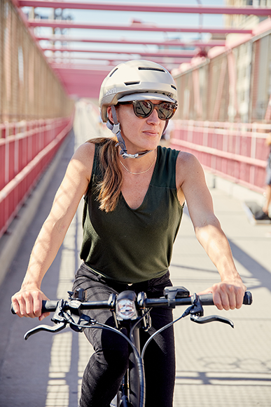 Women wearing Satin Champagne Hudson helmet with sunglasses on the Brooklyn Birdge New York, New York