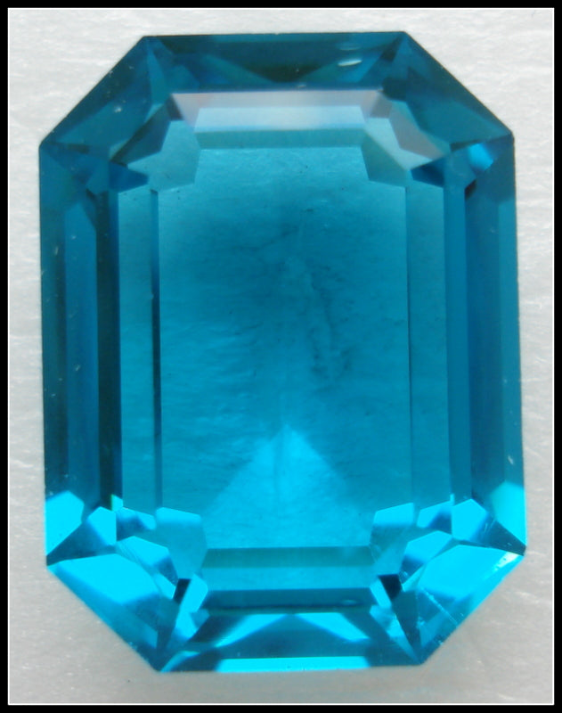 20X15MM (4610) STEP CUT UNF. BLUE ZIRCON CUSHION OCTAGONS