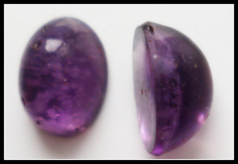 8X6MM (1685) HIGH DOME OVAL FLAWED AMETHYST CABS