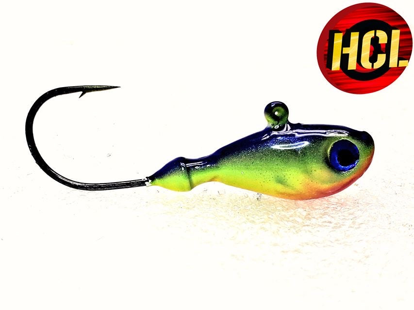 Ultra Minnow Jig that is custom painted in shimmering iridescent yellow chartreuse, coupled with a blue top and an orange nose comes complete with 3D eyes and an extremely sharp upgraded black nickel hook