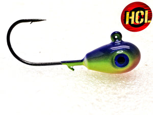 Custom painted Teardrop Jig shimmering iridescent yellow chartreuse body coupled with blue top and an orange nose, realistic 3D eyes, a hardcore finish and a needle point exceptionally sharp black nickel hook.