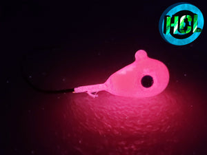 Halo Glow Pink Teardrop jigs with realistic blue 3D eyes, and a durable granite hard finish. They glow strongly when charged with a UV Flash light.