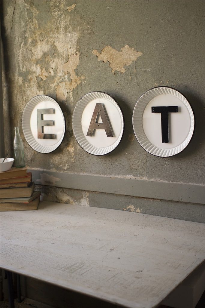 "White And Black Tin ""Eat"" Sign"