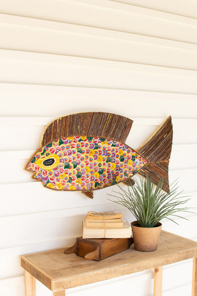 recycled twig and bottle cap fish wall art