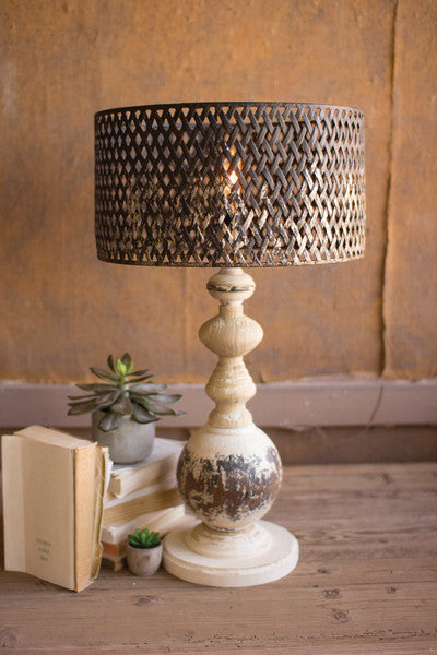 table lamp with round metal base and perforated metal shade