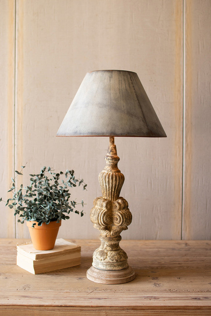 table lamp with sculpted base and galvanized shade