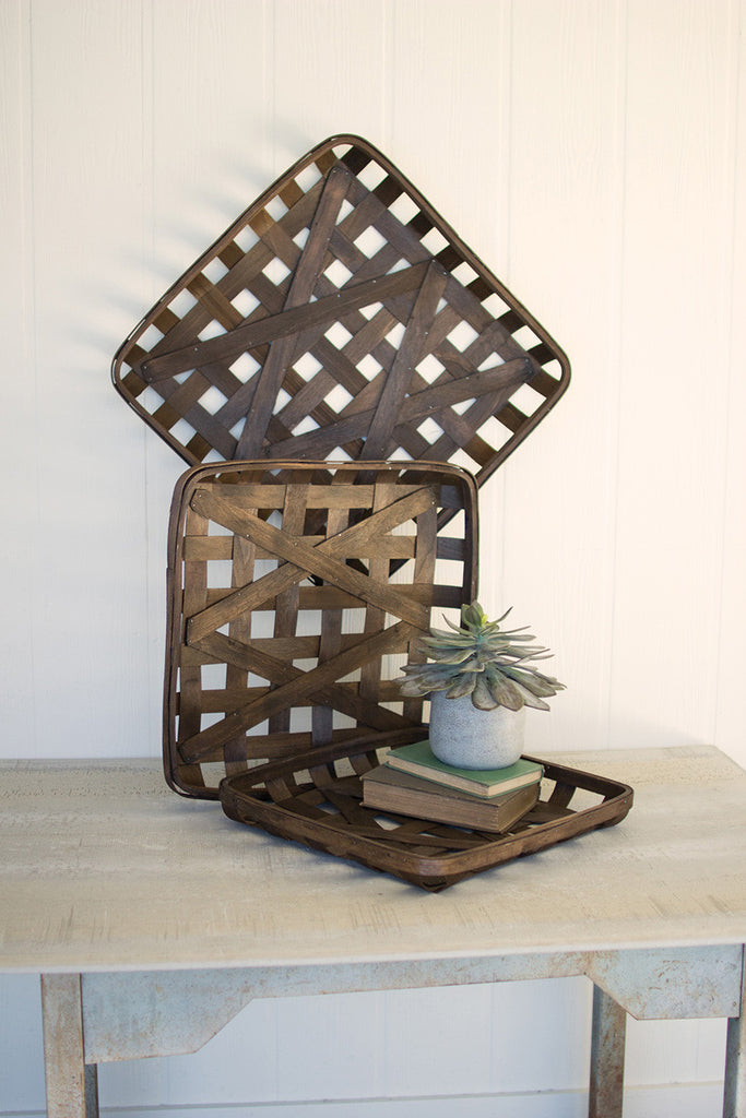 set of three dark brown square woven split wood baskets