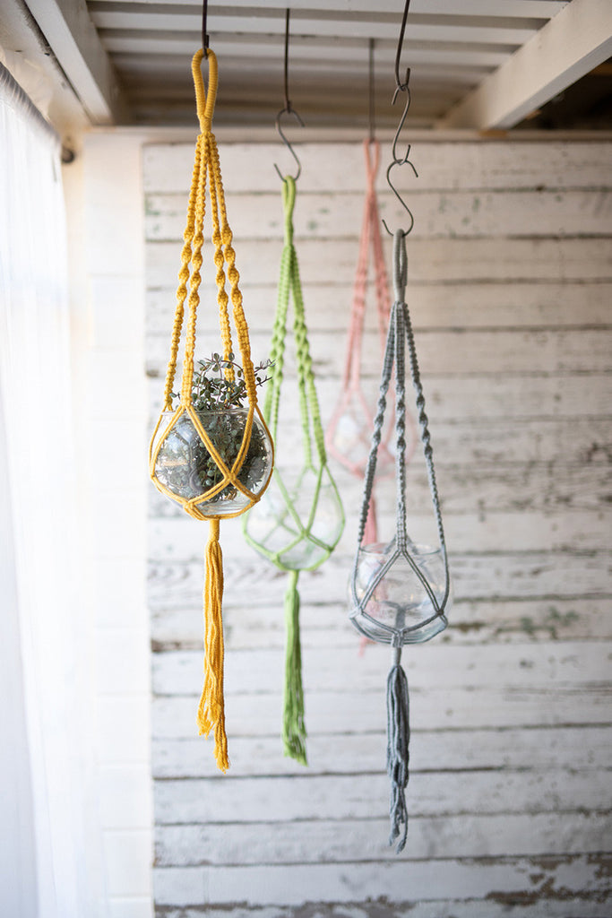 set of four hanging glass vases with cotton macrame