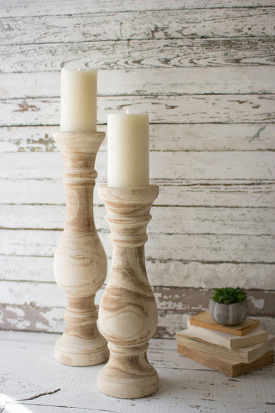 set of two hand carved wooden candle stands