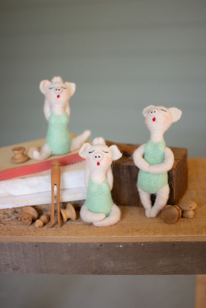 set of three felt yoga pigs