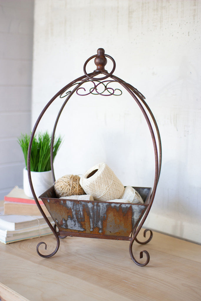 rustic metal basket on a stand