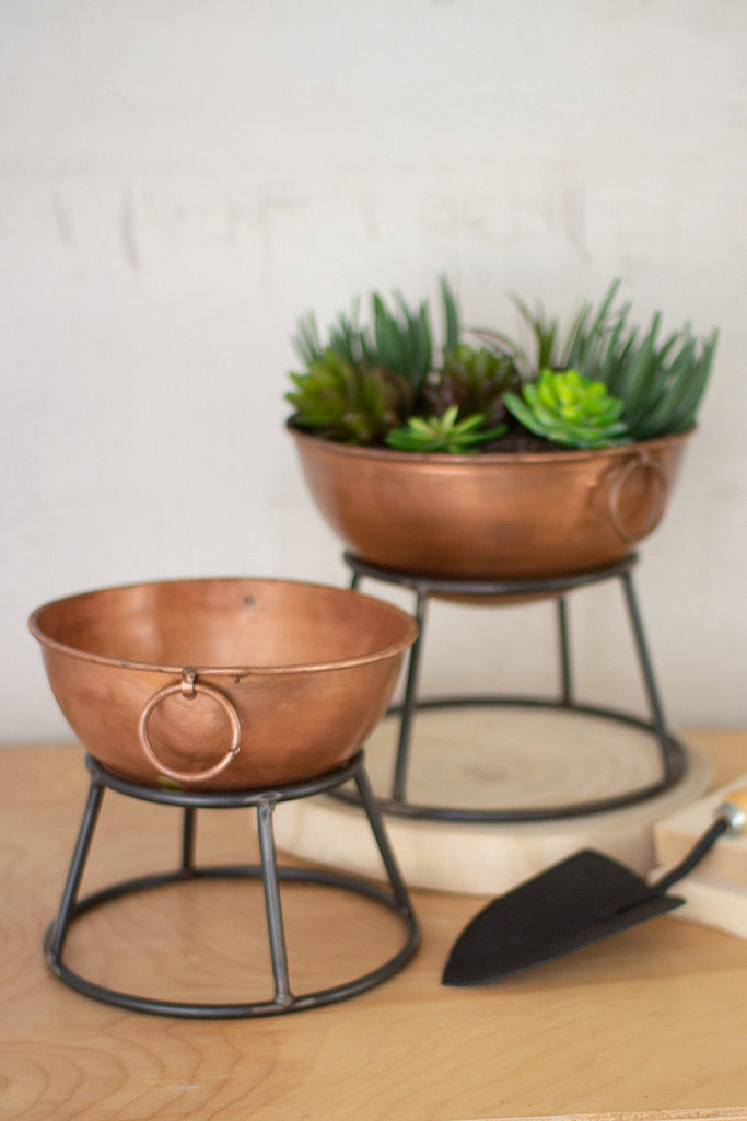 set of two round copper finish bowl planters with metal stands