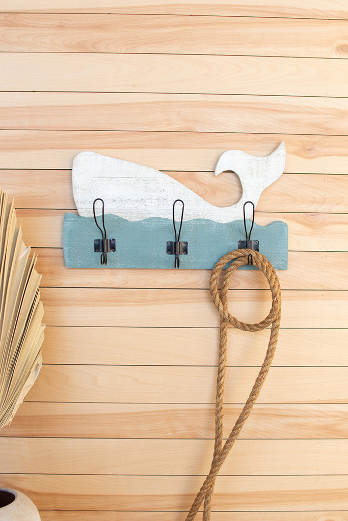 rustic white and turquoise wooden whale coat rack