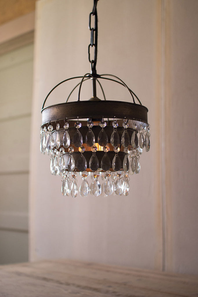 pendant lamp with layered shade and hanging gems