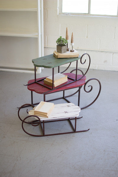 set of 3 painted wood and metal sleighs