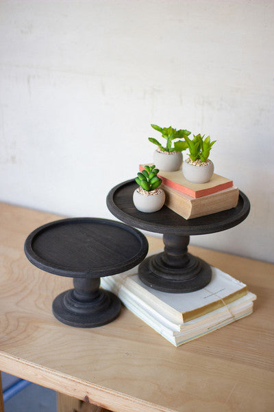 set of two black wooden display pedestals