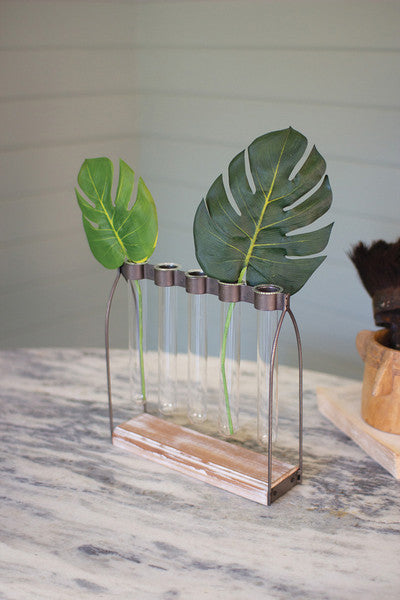 five glass bud vases with metal stand
