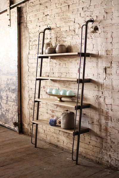 leaning wood and metal shelving unit