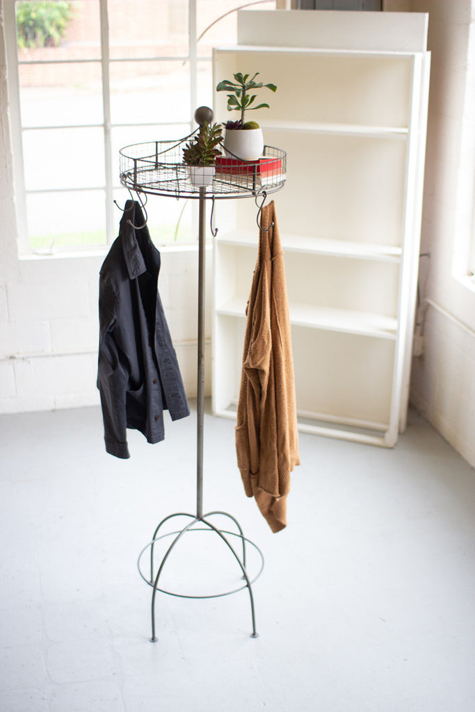 Spinning Basket And Clothes Rack On Tall Stand