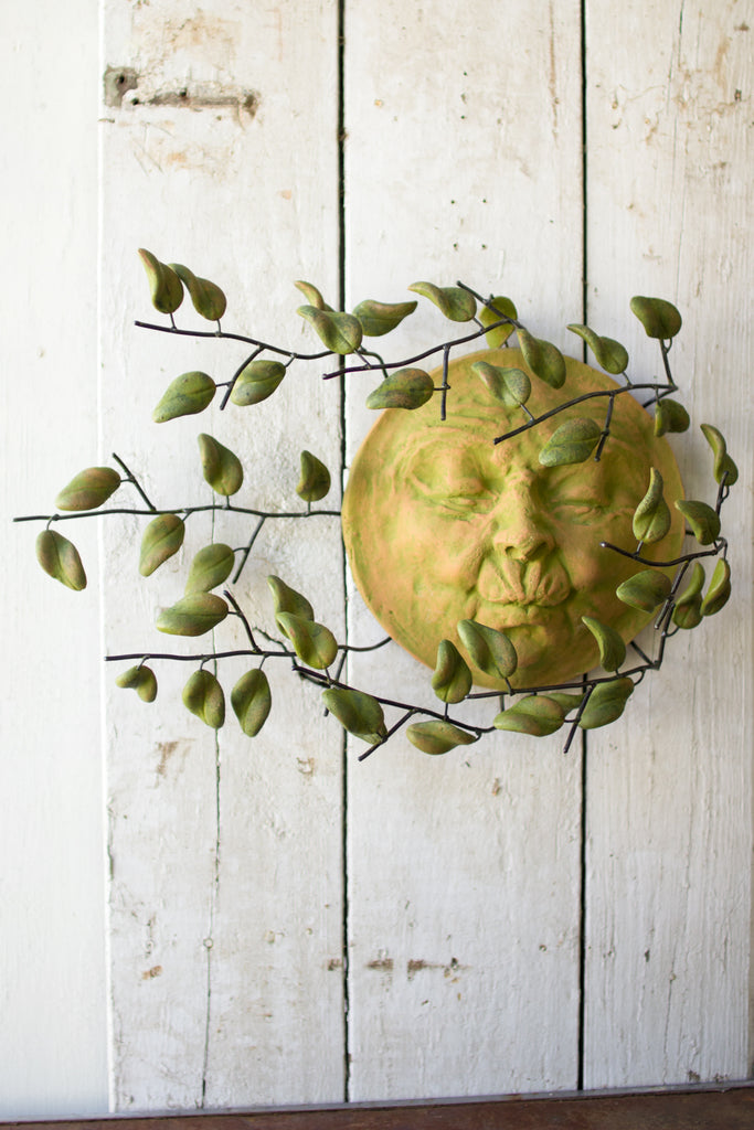 Wind Blown Sun Face With Clay Leaves