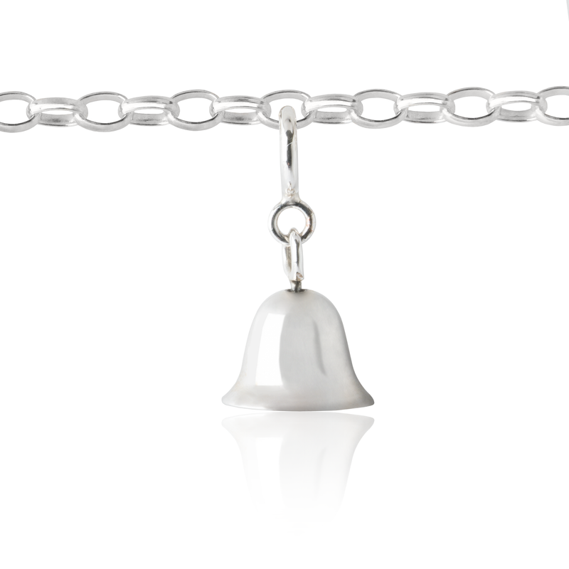 girl's bell charm on children's charm bracelet