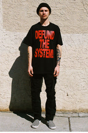 DEFUND THE SYSTEM T-SHIRT