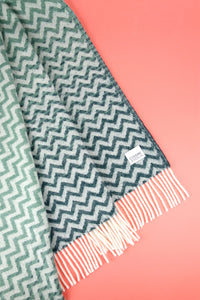 Woolen Throw waves petrol/greenstone
